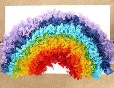 Rainbow from crepe paper.   Small squares, fold around pencil (rubber side), stick in glue, stick on paper. Absolute gorgeous!