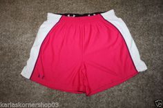 """Excellent used condition UNDER ARMOUR Heat Gear Womens Pink Elastic Waist Athletic Shorts Size Medium Colors are pink, purple, and white with purple logo Has NO pockets and NO drawl string 100% Polyester Waist 29"""" Inseam 5"""" and from waist to hem 14 3/4""""  Returns accepted if not 100% satisfied ( No hassle return policy) *Returned in same condition you received it in. *I pay for returned shipping if it is my fault *If it is your fault you pay for returned Shipping"""