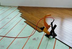 Hardwood flooring attached directly to Warmboard radiant heating panels.