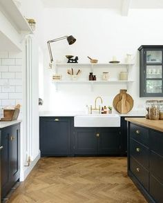 Out Over Your Kitchen Backsplash? Beautiful black and white kitchen by DeVOL kitchens. Love the warmth of the herringbone wood floor and the crisp white in contrast to the chic black and touches of unlacquered brass.Brass monkey Brass monkey may refer to: Devol Kitchens, Home Kitchens, Devol Shaker Kitchen, Shaker Style Kitchens, Country Kitchens, Kitchen Flooring, Kitchen Backsplash, Backsplash Ideas, Black Backsplash