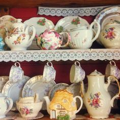 Tea cups and tea pots with lace