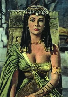 Elizabeth Taylor in the landmark film, Cleopatra. This costume, unfortunately, did not make it into the final release. The lotus crown, hair beads and jewelry are reminiscent of Prince Sit-Hathor Iunet found at Dashur.