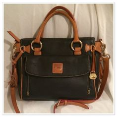 "Dooney & Bourke Medium Satchel EUC- Authentic Dooney & Bourke / Black pebbled Leather with Tan Trim. 11"" across x 9"" in length x  4"" wide x 5"" handle drop and the removable strap can adjust from 42"" to 46"" this bag is clean and flawless inside and out except for some slight water spots (pictured) on the removable strap Dooney & Bourke Bags Satchels"