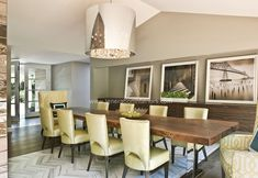 love the herringbone marble floor, love the chairs in citrine, love the large pics on the wood buffet, and looove that table.