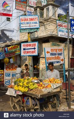 man-selling-fruit-from-a-cart-in-front-of-hand-painted-advertising-D5H1W0.jpg 863×1,390 pixels