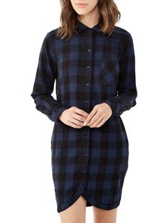 We lengthened your favorite winter shirt to create this Yarn Dye Flannel dress. Made with 100% cotton, it features a chest pocket and full buttons.