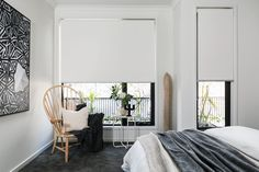 Simple white coloured blockout forward rolled roller blind.                                                                          |                                                                          Window Furnishing: Roller Blinds                                                                          |                                                                          Room: Bedroom