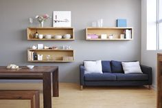 all - contemporary - living room - built-in wood floating shelves and modern dining table with deep wood tones.