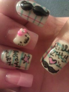 Binder paper and hello kitty love's mustache nails.