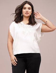 Lane Collection's high-low top brings a modern silhouette to life with paillette embellishments for a touch of subtle shine.  Sleek woven construction makes it an ideal addition to your work-to-weekend collection, with a flattering scoop neckline and cross strap detail in back. Cap sleeves.  lanebryant.com