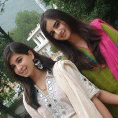 Pakistani girls in white and green salwar kameez