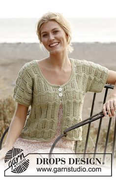 """Knitted DROPS jacket with short sleeves and lace pattern in """"Cotton Light"""". Size: S - XXXL"""