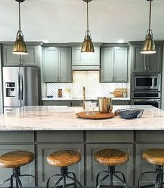 Kitchen renovation from Open Concept on HGTV... LOVE this! Kitchen cabinet color is Anonymous by Sherwin-Williams. Backsplash Tile is from The Tile Shop and the stools are from World Market. Countertops are Crystal Fantasy Quartzite :-)