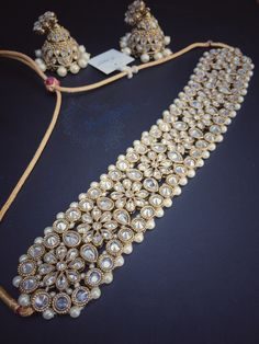 An absolutely stunning #choker set which sits right at the top of the bare neck, made from #antique #kundan and #pearls. #Simple #stones...yet when combined together it creates #beauty in #jewels. Oh yes, and this #necklace also comes with fancy matching #earrings #jhumka. #regal #royal #elegance #jewellery #eyecandy #potd #instafashion #asiana #bride #bridal #western #eastern #fusion #kaustubhajewels