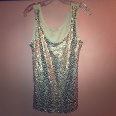 ⬇REDUCED⬇ BR Gold Sequined Tank Top NWT Dazzle in this GLAMOROUS sequined top made exclusively by Banana Republic. Body: 100% Cotton; Mesh: 100% Polyester, Exclusive of Decoration. Bronze and gold metallic sequins adorned the full front of top. NEW WITH TAGS! MSRP $49.50. Listed at $40. Would make a great birthday or holiday gift! Banana Republic Tops Tank Tops