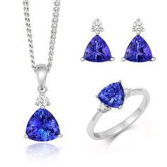 18ct White Gold Tanzanite Diamond Three Piece Gift Set, TVN-353 The pieces that comprise this exquisite gift set feature beautiful Tanzanite gemstones, discovered in the Mererani Hills of Northern Tanzania. They are an embodiment of elegance and luxury with Tanzanite being one of the world's most desired stones. This seductive gemstone can exhibit a variety of surreal colours including blues, violets and burgundies so each piece is truly unique and beautiful.  Ring: Tanzanite 1.12cts… Tanzanite Pendant, Tanzanite Jewelry, Tanzanite Gemstone, Christmas Gift Sets, Latest Jewellery, Rose Gold Jewelry, Jewelry Packaging, Natural Gemstones, Pendant Jewelry