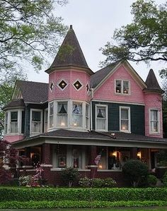 Queen Anne style, Sheffield, AL => with 2 conical roof-line structures.  Very pleasant to look at.