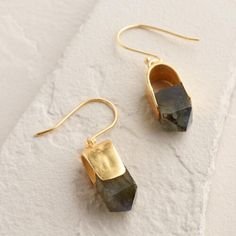Featuring faceted semi-precious labradorite stones with shimmering crystal accents, our handcrafted earrings catch the light cast in gold metal.