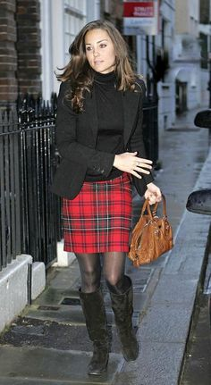 A winter look, complete with a preppy plaid skirt, suede boots, and a Prada bag.