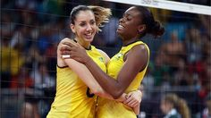 Thaisa Menezes #6 and Fabiana Claudino #1 of Brazil celebrate the win over Japan during the Women's Volleyball semifinal match on Day 13 of the London 2012 Olympics Games at Earls Court