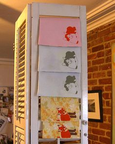 Using an old door or shutter is always a possible way to display tea towels and such!!