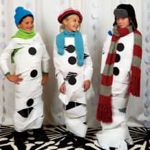 "Dress the Snowman Game - First team to dress up their snowman and get them to the finish line with the ""least amount of melting"" wins!"