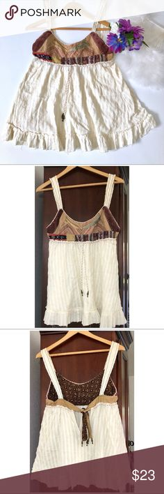 Free People tunic top cream raw edges size 4 Free People size 4. Cream and tan . Raw edges. Empire waist with a drawstring. Patches detail on the to area. Open back detail. Music festival season Music festival outfits Free People Tops Tunics