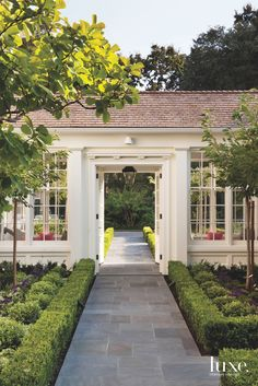 A Turn-Of-The-Century Home Flourishes Once Again - Luxe Interiors + Design Porte Cochere, Breezeway, Building A New Home, Porches, Cottage Style, Exterior Design, House Tours, Landscape Design, House Landscape