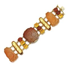 Chalcedony and citrine bracelet, Seaman Schepps, 1950s Composed of three carved chalcedony snuff bottles of foliate designs, accented with facetted and polished citrines, length approximately 190mm, signed Seaman Schepps