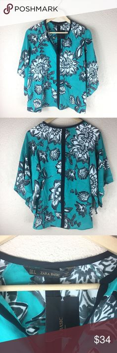Zara floral batwing pullover black white blue top This Zara top is in perfect condition and has never been worn it still has tags on it. The flowers have a hand painted look to them. It's light weight and perfect for spring and summer. Zara Tops Blouses