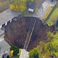 An aerial photo shows a massive crater that appeared in a residential street in Schmalkalden, Germany, in November 2010