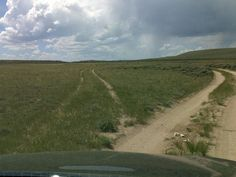 Wagon wheel ruts at parting of the Ways at South Pass, Wyoming.  On the right, the Oregon Trail. On the left, the California Trail.