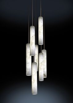 Sumatra is a light which uses a single piece of alabaster. Geometric and pure: it is a long backlit stone cylinder. Each cylinder is suspended by a rod and this structural support allows for a power supply to be included. The association of suspende Room Lights, Ceiling Lights, One Hyde Park, Family Room Lighting, Alabaster Stone, Lamp Design, Wind Chimes, Interior Inspiration, Light Up