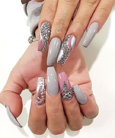 Demon Coffin Nails with Glossy Pink and Grey. This wholly studded pink and grey coffin air art design is truly an inspiration for all those girly girls out there.