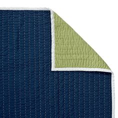 Navy/Clover Cabin Quilt | Serena & Lily | white binding and stitching, navy blue on one side, lime green on the reverse