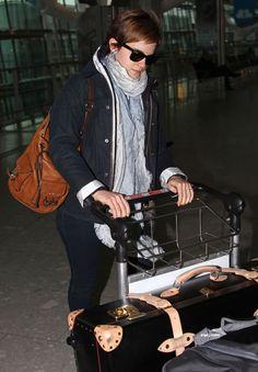 Emma Watson traveling with a Globe-Trotter safari suitcase.