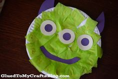 """Easy Alien {Kid Craft}  I decided a themed craft was in order. {because that's what crafty moms do} Which led into a search through my stash of supplies, looking for the perfect shade of green tissue paper. Then after an hour later of our time """"crafting"""" we had this """"Easy Alien Craft"""" displayed on our fridge. It's mainly inspired by those cute little aliens in the movie.  This would be a cute way to decorate a classroom especially if you had an outer space theme."""