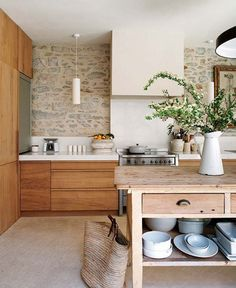 Mixing stone and wood gives this country kitchen a fresh appeal