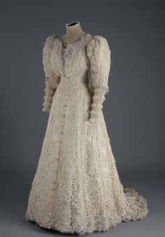 1895 afternoon gown of delicately assembled tape lace with details of other laces.