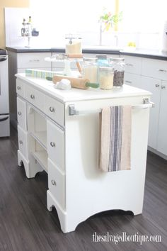 The Salvaged Boutique upcycles another vintage desk to create a traditional rolling cart in white and accented with silver rope wood trim. Staged for the baker at heart.