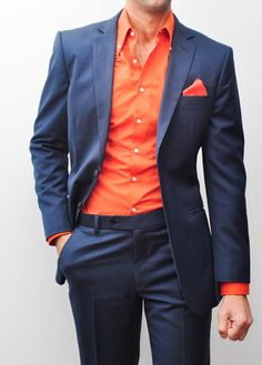 "Feroce Blue Custom Suit – This super 160s Italian wool suit contains several layers of alternating navy blue, light blue and white threads creating a material which genuinely looks one of a kind. Shown with ""pick"" stitching running along the edge of the lapel, this suit is a must have for any gentleman looking to make a statement."