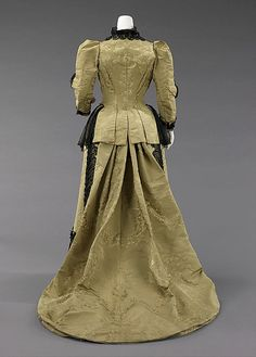 House of Worth  (French, 1858–1956)    Designer:      Attributed to Charles Frederick Worth (French (born England), Bourne 1825–1895 Paris)  Designer:      Attributed to Jean-Philippe Worth (French, 1856–1926)  Date:      1893  Culture:      French  Medium:      silk, jet, metal  Dimensions:      Length at CB (a): 40 in. (101.6 cm) Length at CB (b): 14 in. (35.6 cm) Length at CB (c): 28 in. (71.1 cm) 4 x 10 in. (10.2 x 25.4 cm)  Credit Line:      Brooklyn Museum Costume Collection at The Met...