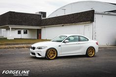 Taylor McGohan's BMW F87 M2 on H&R Sport springs, Hoosier R7 tires, and 19x9.5 & 19x10.5 Forgeline one piece forged monoblock GA1R Open Lug wheels finished in Transparent Gold! See more at: http://www.forgeline.com/customer_gallery_view.php?cvk=1697 Photos by Elliott Heigel. #Forgeline #forged #monoblock #GA1R #OpenLug #notjustanotherprettywheel #madeinUSA #BMW #F87 #M2 #Hoosier #R7