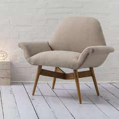 The Carnaby is inspired by retro styles, but with contemporary influences weaved in.The neatly-turned, solid mango wood legs and gentle curves hark back to classic mid-century styling, while the oatmeal wool upholstery is thoroughly modern.