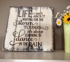 Life Isn't About Waiting For the Storm to Pass Rustic Wood Sign, Inspirational Sign by Wood Finds. Seize the day and make the most of each moment with this rustic sayings sign as a lovely reminder in your home or work space. Artistically designed in breathtaking detail, it features a hand painted pine wood board that is distressed in a farm house chic ambiance. The text is hand painted in acrylic using a variety of fonts to make a memorable impression. Display it in a master bedroom or…