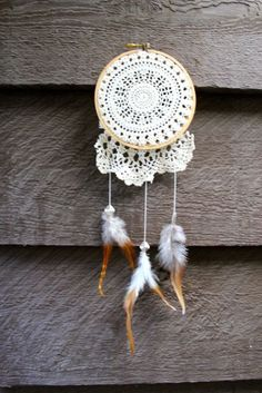 * small embroidery ring   * lace  * feathers  * silver patterned beads  * twine   * scissors
