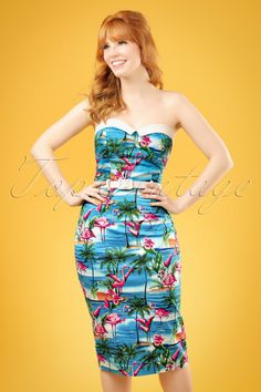 This50s Monica Flamingo Island Pencil Dress is a tropical dream coming true! Monica has been one of our favourite dresses of all-time but we've never had one as fun as this one! This pencil style oozes sexyness; from the sweetheart neckline with contrasting white little fold-overs to the curvalicious cut, oh la la. Made from a sky blue cotton blend with a light stretch and afantastic print of flamingos resplendent on a background of perfect blue seas and sandy beaches...