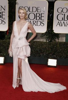And she does it again. In 2012 Charlize Theron was exquisite in Dior. The Best Actress nominee was stunning in pale pink with her Givenchy heels and Cartier jewels. Check out which stars made our TOP 10 looks from the last 10 years and build your own Red Carpet closet at www.BattleShop.co!