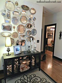 Buy thrift store silver platters and stick them on your wall for a pretty display!  #silver #silverplatters #thriftstoreplatewall