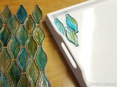Make an old tray new by adding tile, broken glass, or ANYTHING and pouring on epoxy! {Sawdust and Embryos}